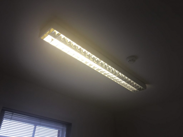 Picture of what the office lighting looked like before the new LED tubes were installed